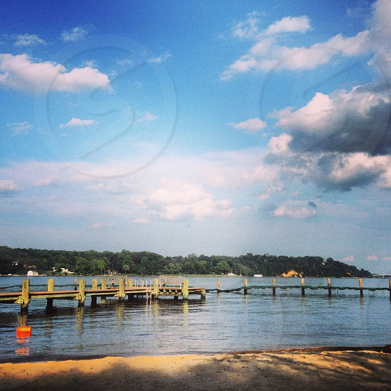 cumulus cloud and sea with foot bridge photography  photo
