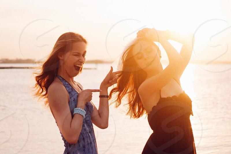 Sunset summer friends girls fun having fun photoshoot sun sunny funny happy happiness photo