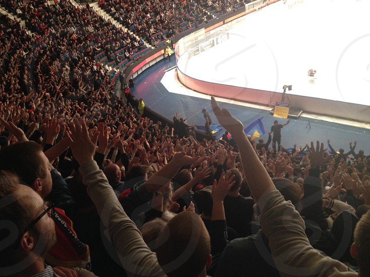 Fans ice hockey supporters cheering. photo