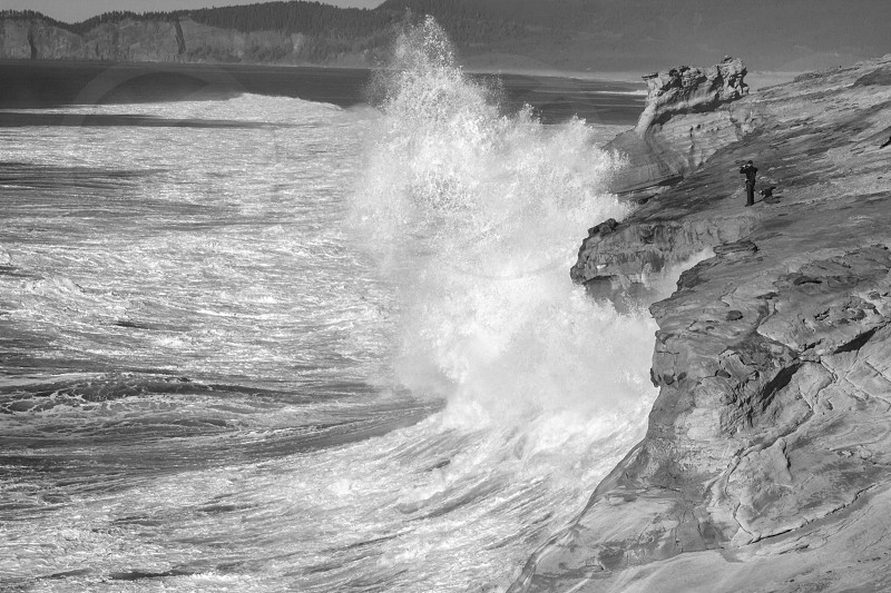 Man Photographs Big Swell Oregon Coast photo