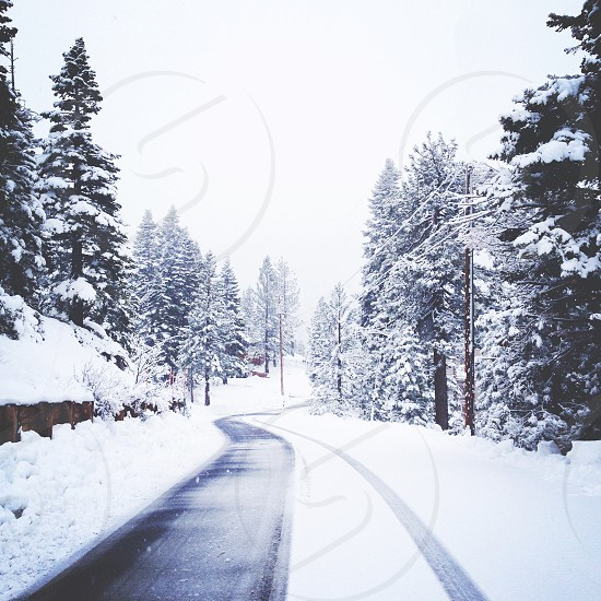 view of the road with snow on the side photo