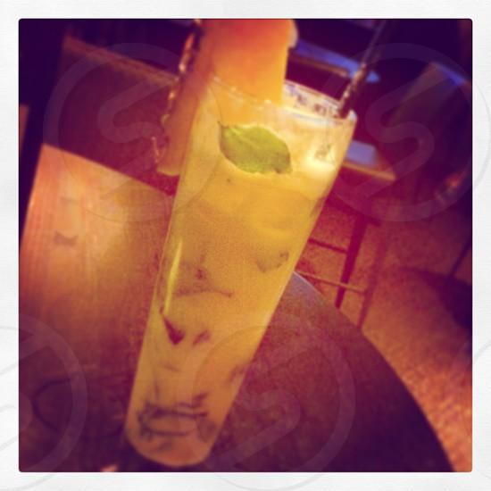 white juice on pint glass photograph photo