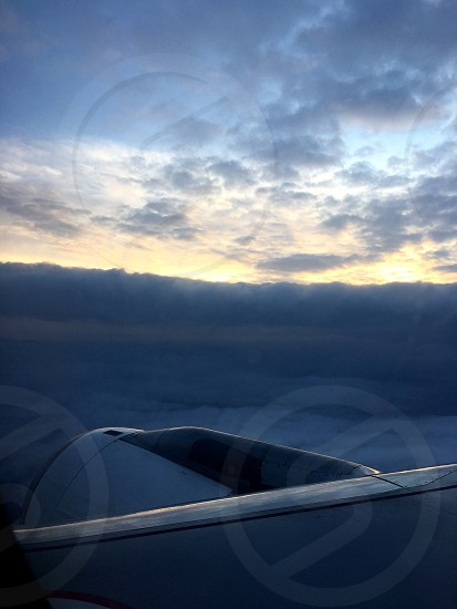 Along with the clouds. At an altitude of nine thousand meters. Wings of the aircraft. Unique photo frames. photo