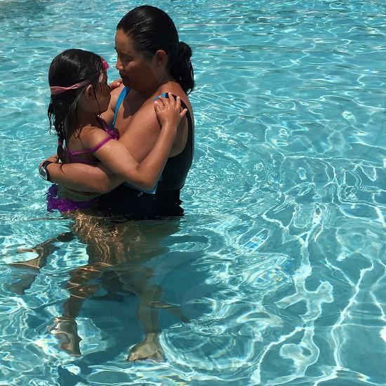 woman wearing black leotard in pool photo
