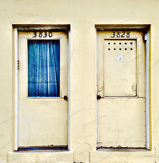 two closed doors number 3830 and 3828 photo