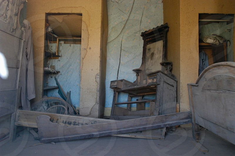 Abandoned home. Ghost town. Bedroom. Dust. photo