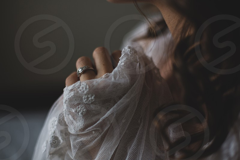bride bridal wedding veil engagement ring ring engaged marriage feminine lifestyle big day celebrate anticipation wait love romance romantic elegant stylish styled classic beauty beautiful jewels hands detail gown bridal gown wedding gown wedding dress dress nuptials forever promise photo
