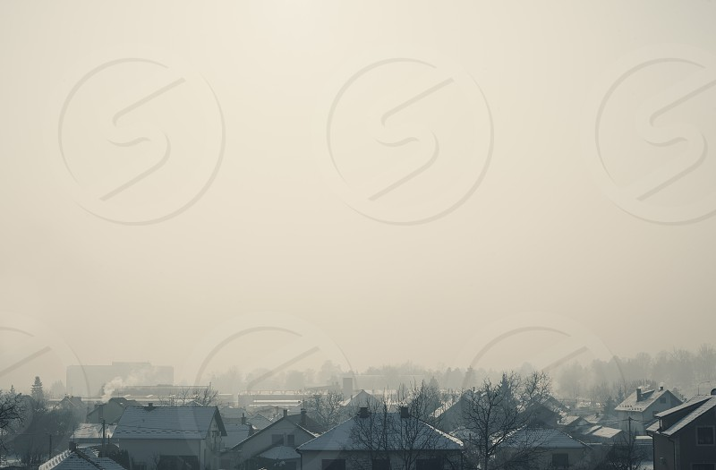 Abstract composition of a settlement just roofs of houses and empty sky space beyond.  photo