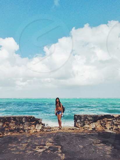woman standing on the ocean vie w photo