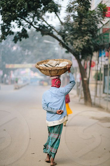 Man walking poverty India Bangladesh  photo