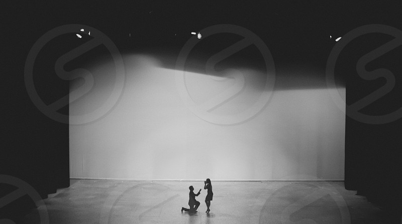 Tango dancer surprises his girlfriend onstage at the end of their act. photo