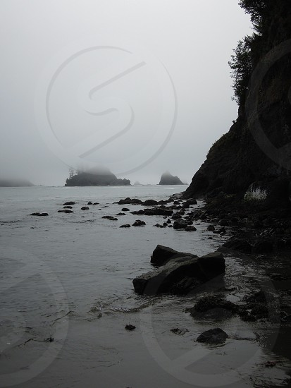 Black and White photo I took of some sea stacks of the Washington coast during a hike at La Push. The fog was heavy which gave some interesting depth with different stacks more or less concealed depending on how far out they were.  photo
