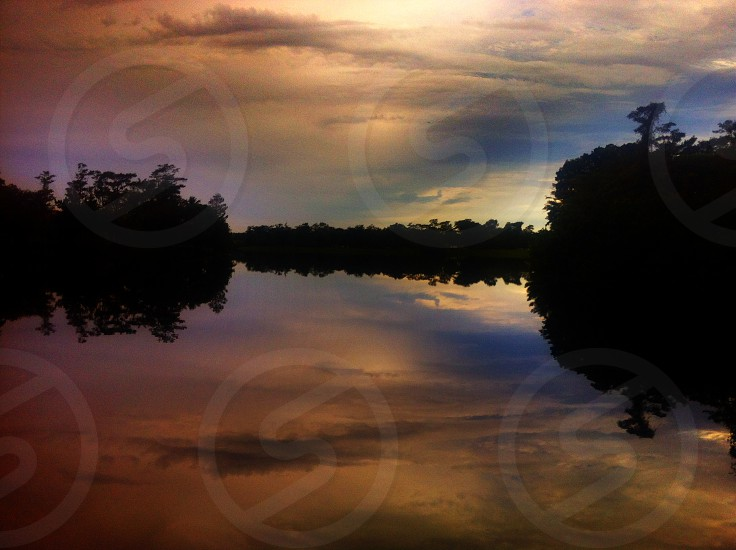 lake reflections trees sunset clouds water florida photo