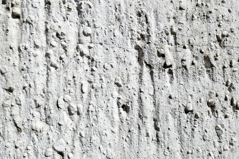 full frame texture of traditional plasterwork at wall. white painted. photo