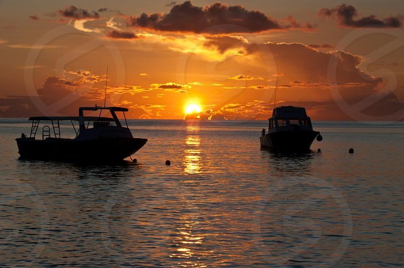Sunset Ocean boats coast photo