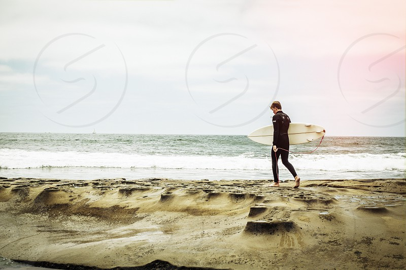 Surfer surf ocean summer getting ready San Diego water  photo