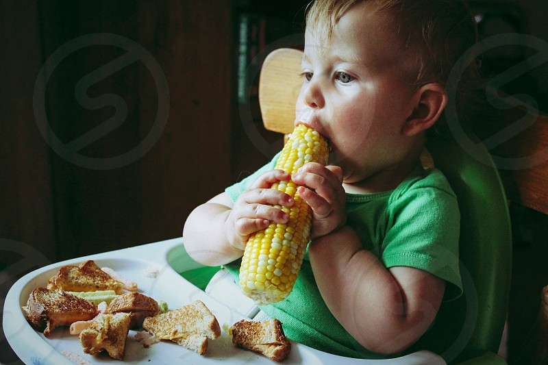 Vegetables corn  summer summertime eating food baby  child  photo