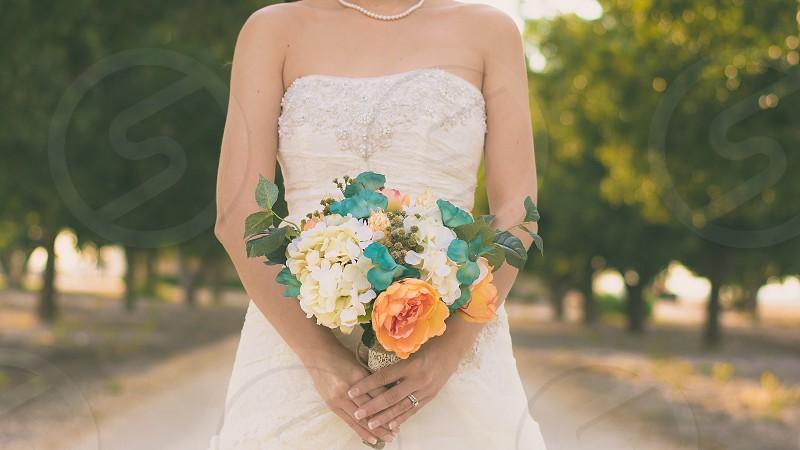 Bride bridal wedding wedding dress bouquet flowers  photo