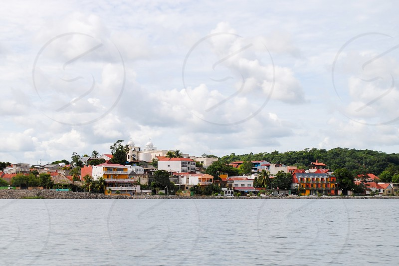 A view of Flores Petén Department from a boat on lake Petén Itzá.  photo