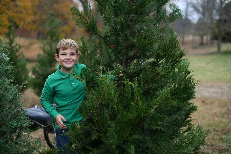 Boy Christmas Tree tree farm cutting down the tree Christmas photo