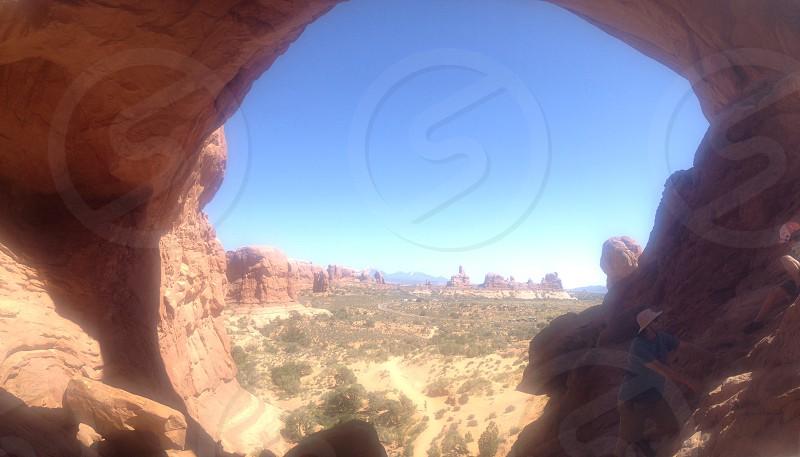desert view through a rock archway photo