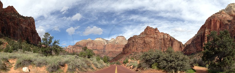 road passing through rock formations photo