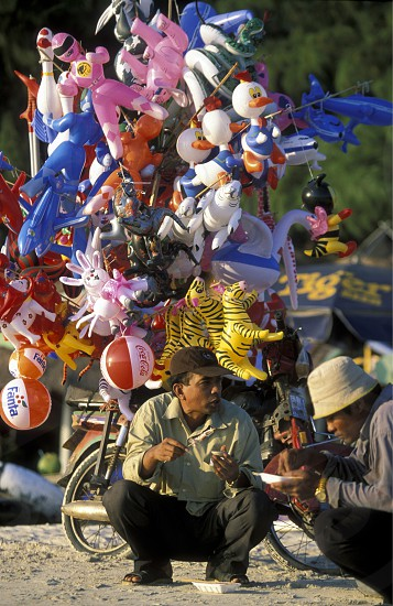 a men sales ballons at the beach at the coast of the Town of Sihanoukville in cambodia in southeastasia.  photo