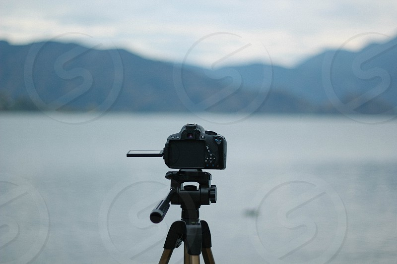 DSLR Camera and the mountains photo
