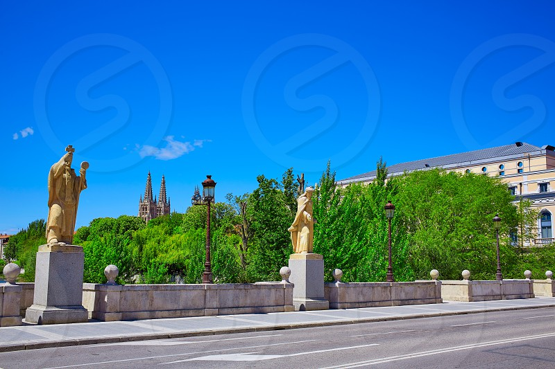 Burgos San Pablo bridge Statues and Cathedral over Arlanzon river in Castilla Spain photo