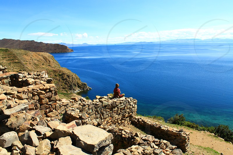 Meditation in ancient ruins of Isla del Sol. Spiritual ocean retreat. Peace and solitude. photo