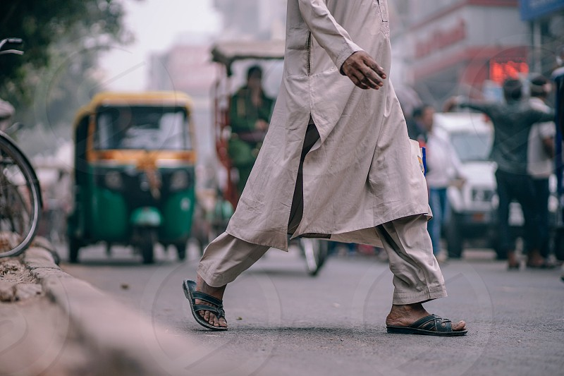 Walking across the road in New Delhi India. photo