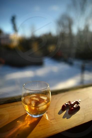 whiskey whiskey glass rye glass of rye winter scene window ledge on the rocks window view. photo