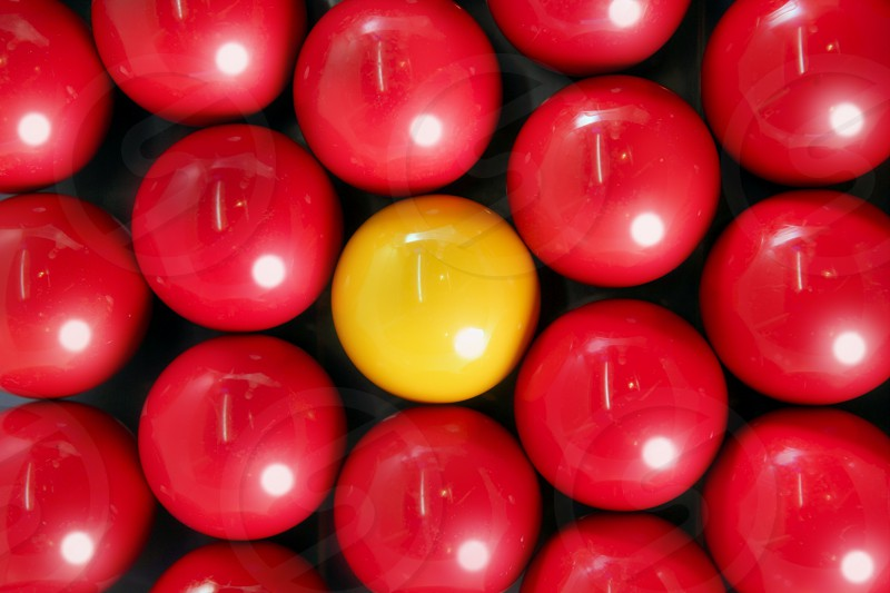 Alone billiard one yellow ball between many red balls background pattern texture photo