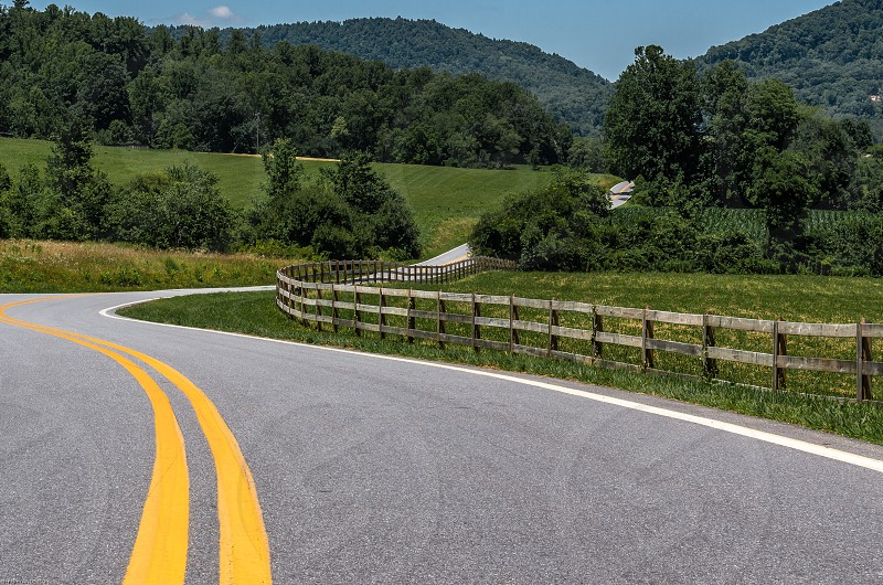 Winding Country Roads Mountains Rail Fence Corn Fields Pasture Blue Sky photo