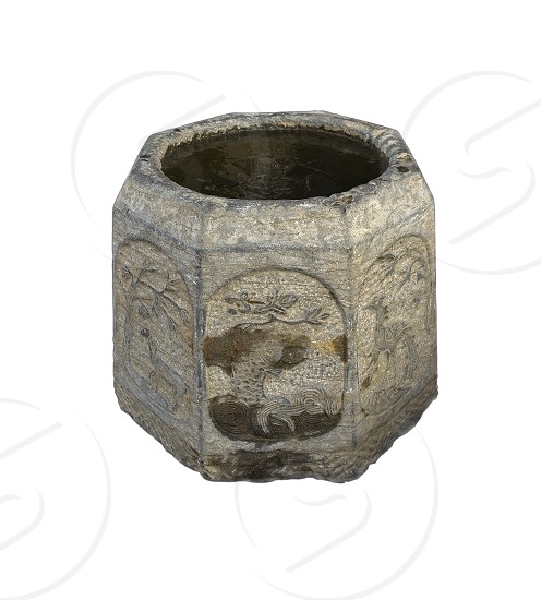 ancient stone bucket finely carved with iced water over white backgroungd photo