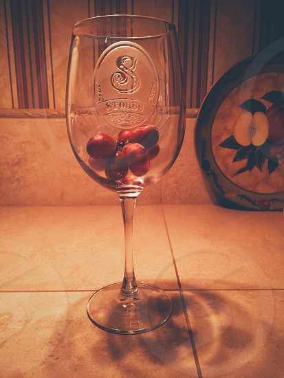 Wine glass with grapes photo