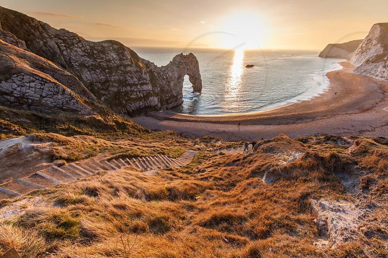 Durdle Door jurassic coast Dorset England sunset coastal landscape.  photo