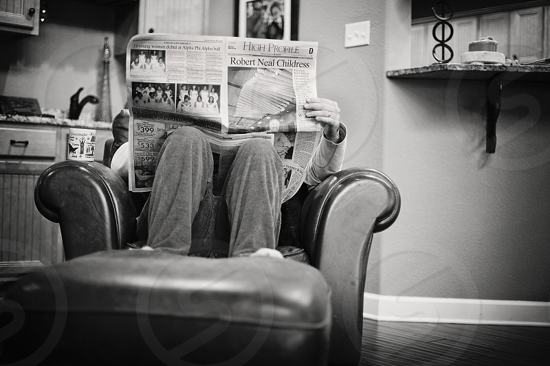 Drinking coffee and reading the newspaper photo