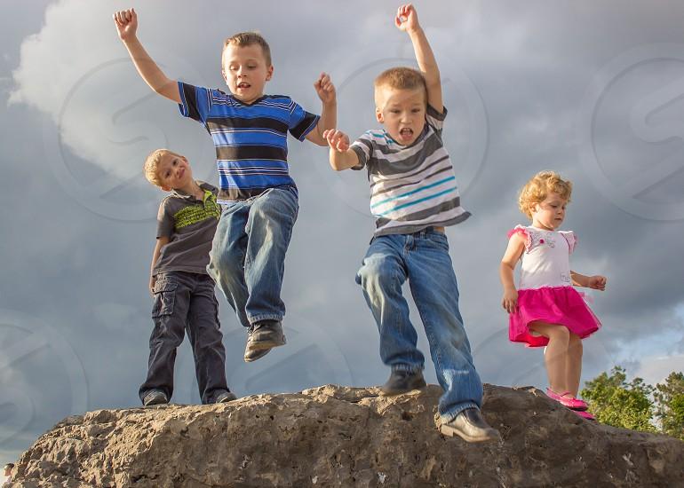 4 kids standing photo