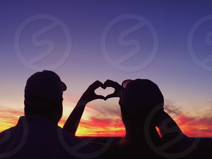 Sunset silhouette love heart framed frame people couple photo