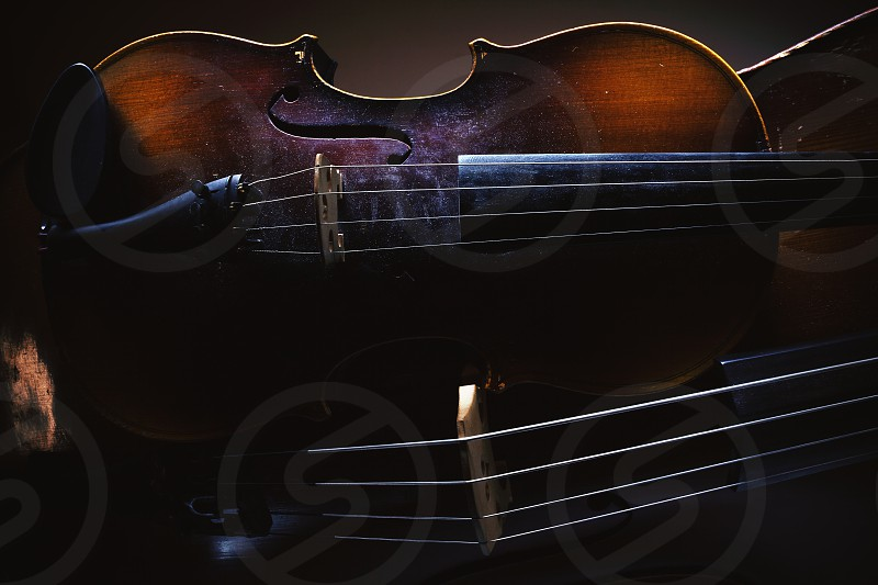 Details of old violin and cello accentuated shapes and textures.  photo