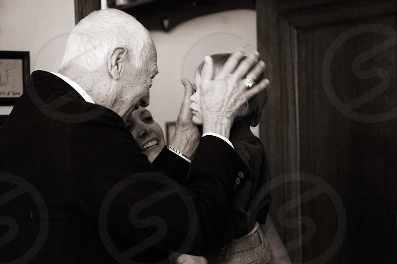 man touching head of girl photo