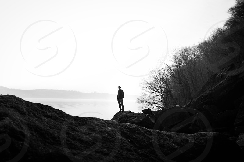 man in black and white surroundings photo photo