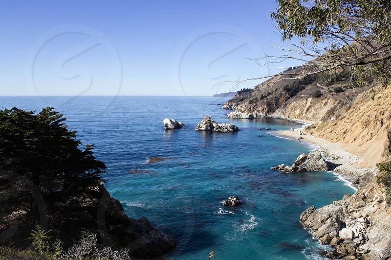 Big Sur California. Water ocean rocks blue sunny clear. photo