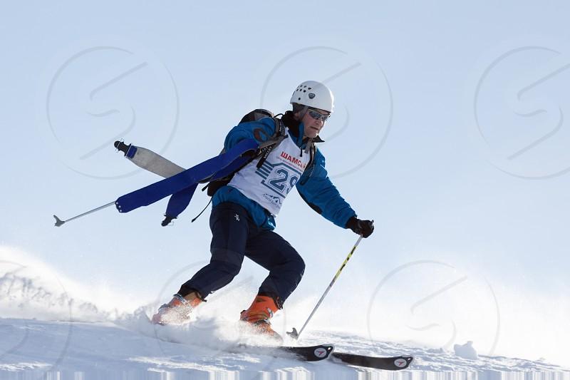 KRASNAYA SOPKA PETROPAVLOVSK KAMCHATKA RUSSIA - FEB 4 2012: Ski mountaineer rides skiing on mountain on background of sky. Ski-mountaineering competitions - Cup Petropavlovsk-Kamchatsky City. photo