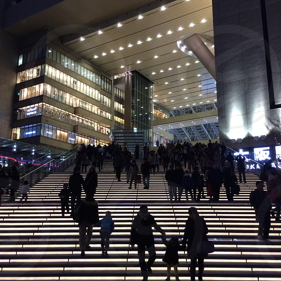 people walking on lighted staircase photo