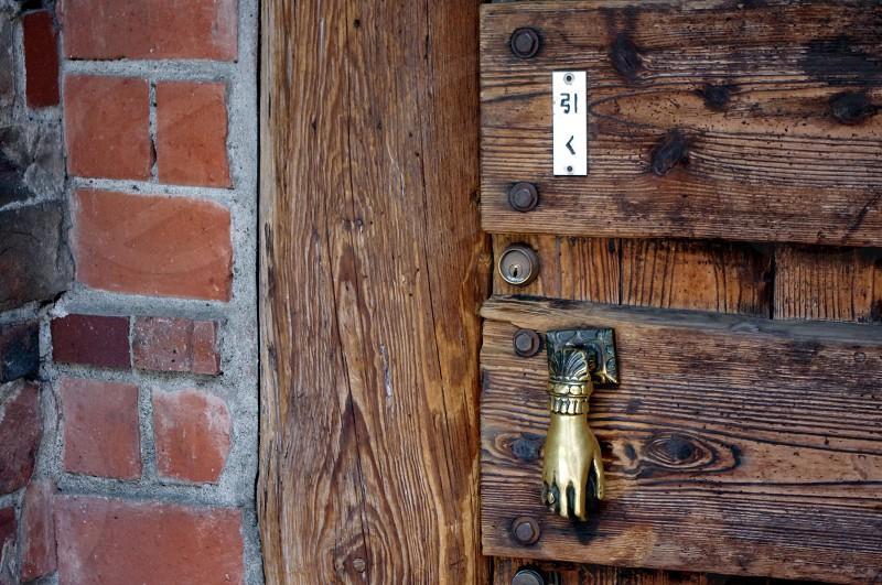 A rustic door with golden hand door pull in Tokyo Japan  photo