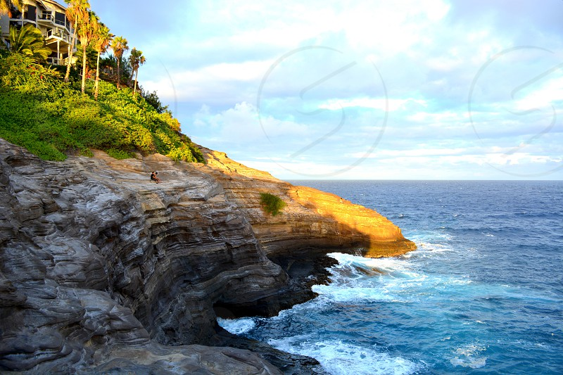 rocky cliff near sea photo