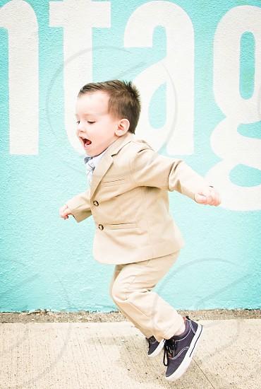 jumping little boy joy rowdy toddler photo