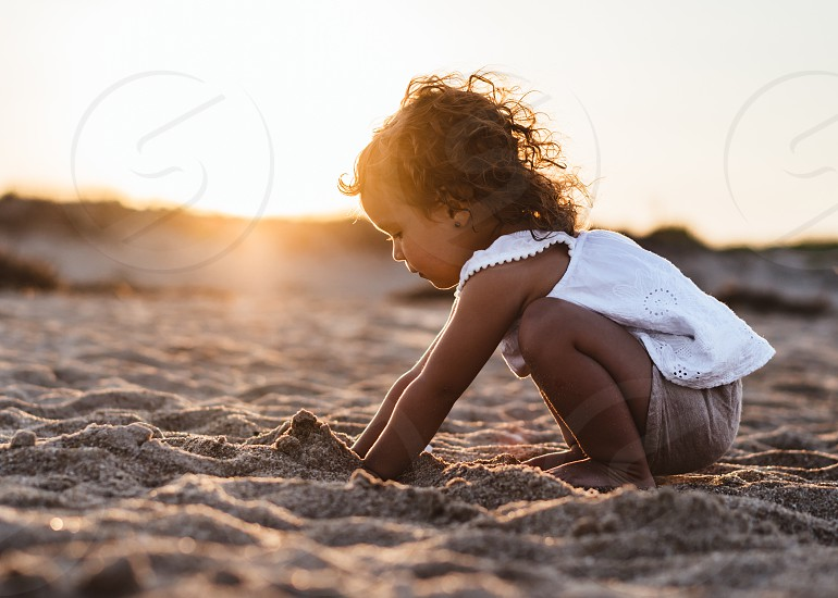 Summer fun; digging in the sand; beach; sunset; toddler photo